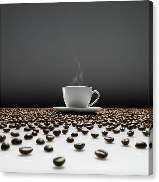 A Cup Of Coffee Sitting In The Middle Canvas Print
