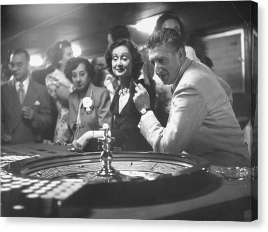 A Group Of People Gambling At A Roulette Canvas Print by Gordon Parks
