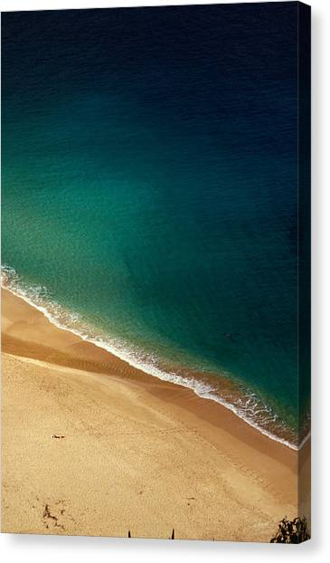 A Lone Sunbather Stretches Out On The Canvas Print