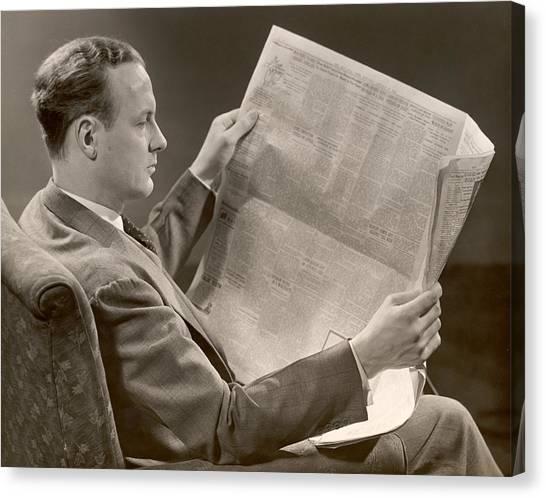 A Man Reads A Newspaper Canvas Print