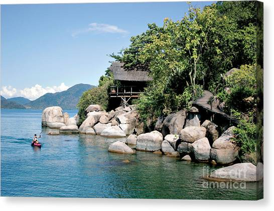 Canoe Canvas Print - A Paddler Explores The Scenic Rock by Saphotog