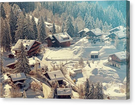 A Quaint Village In The Swiss Alps Canvas Print by Saphotog