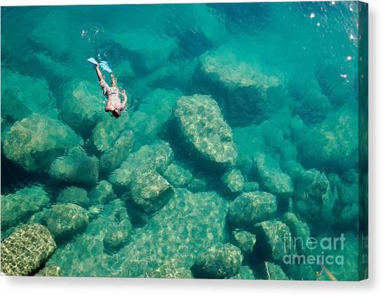 Canoe Canvas Print - A Snorkeler Explores The Scenic Rock by Saphotog