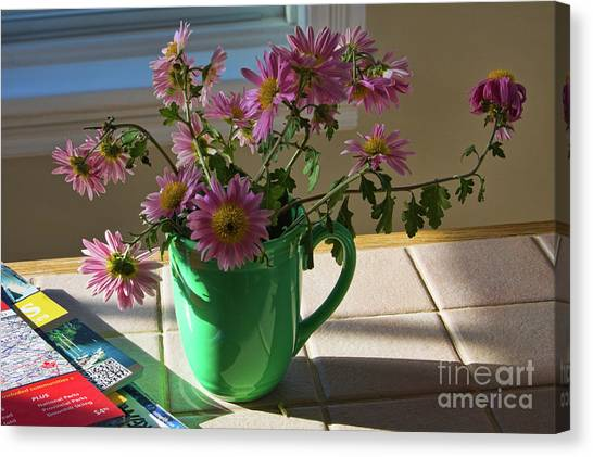 Canvas Print featuring the photograph A Traveler Still Life With Autumn Flowers by Tatiana Travelways