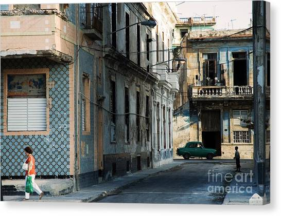 Urban Decay Canvas Print - A View Of Crumbling Buildings In Havana by Roxana Gonzalez