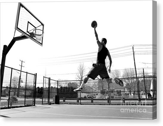Basket Canvas Print - A Young Basketball Player Flying by Arena Creative