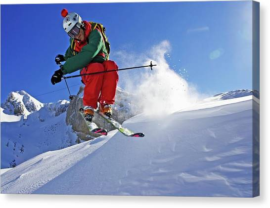 A Young Skier, A Freerider Jumps Over A Canvas Print