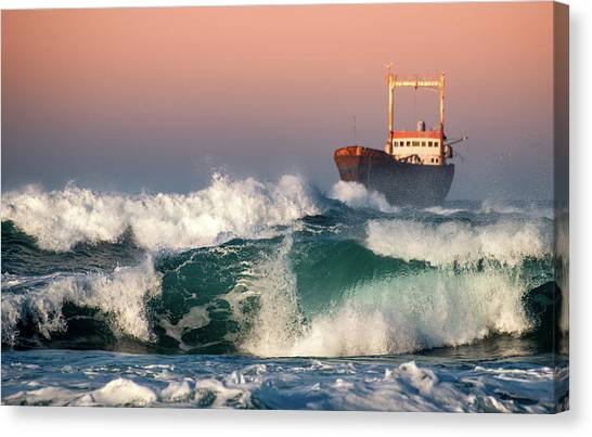 Abandoned Ship And The Stormy Waves Canvas Print