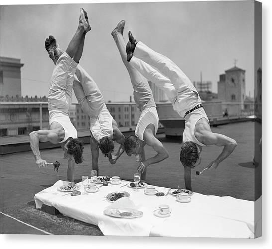 Acrobats Eat While Doing Handstands Canvas Print by Bettmann