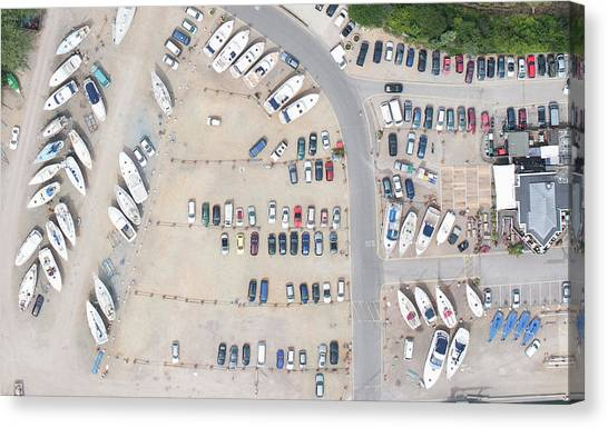 Aerial View Of Dock And Parking Lot Canvas Print by Floresco Productions