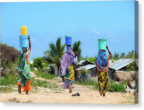 African Women Go To Fetch Water W Canvas Print by Volanthevist
