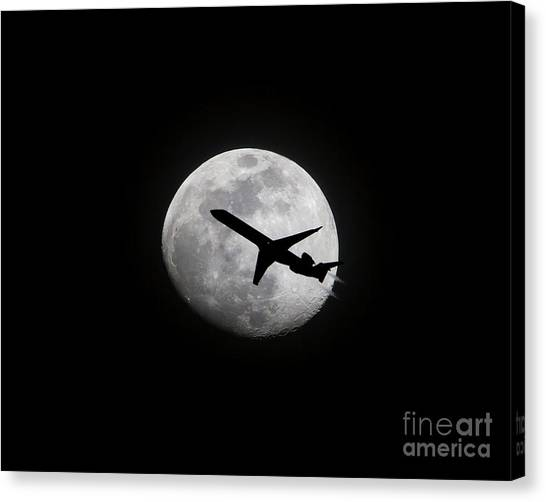 Airliner Passing In Front Of A Full Moon Canvas Print