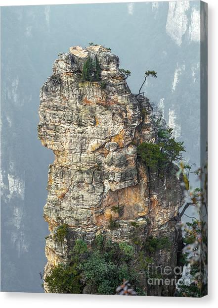 Stunning Canvas Print - Alone Rock Column Mountain Avatar by Vadim Petrakov