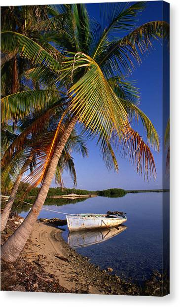 An Empty Boat Rests In Still Water Of Canvas Print