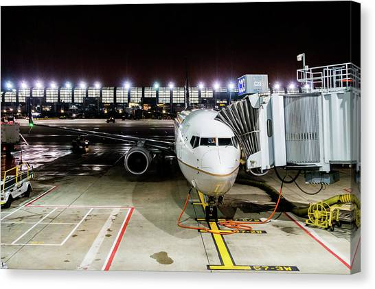 Canvas Print featuring the photograph Arrivals And Departure On Airplane At The Airport by Alex Grichenko