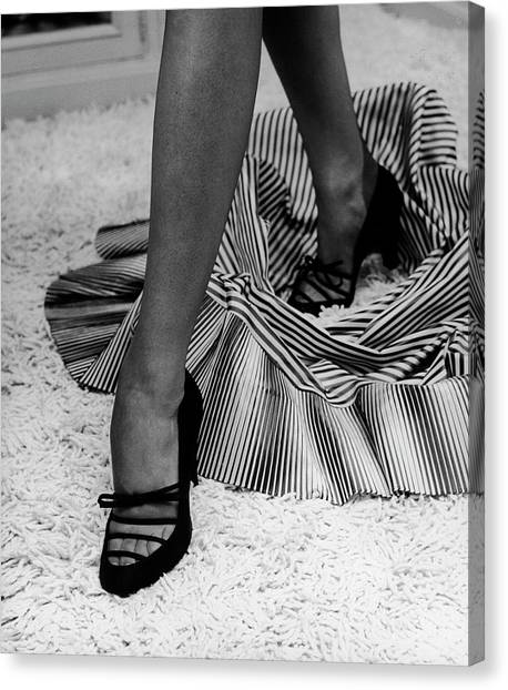 Artful Shot Of Model Showing Off A Pair Canvas Print by Nina Leen