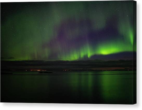Aurora Borealis Reflecting At The Sea Surface Canvas Print