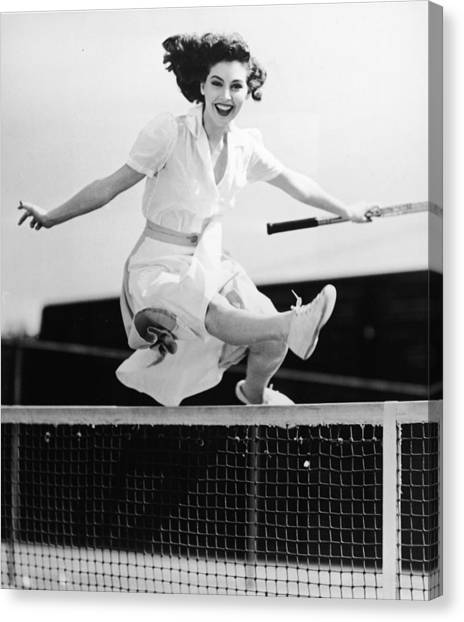 Ava Gardner Jumps Net On Tennis Court Canvas Print