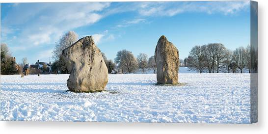 Avebury Stone Circle In The Snow Panoramic Canvas Print by Tim Gainey