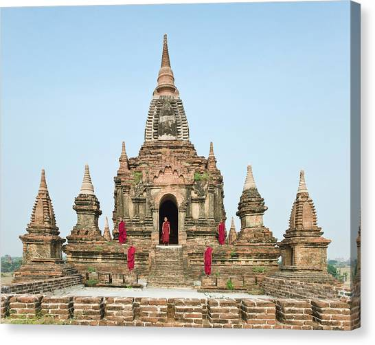 Bagan,buddhist Monks Standing On Temple Canvas Print by Martin Puddy