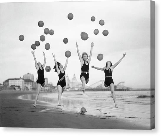 Balloon Dancers On Long Beach Canvas Print by Bettmann