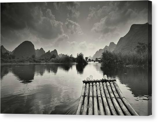Bamboo Raft On Li River Canvas Print