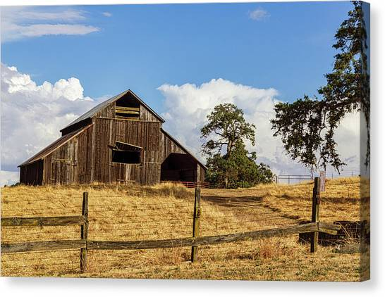 Barn With Fence In Foreground Canvas Print