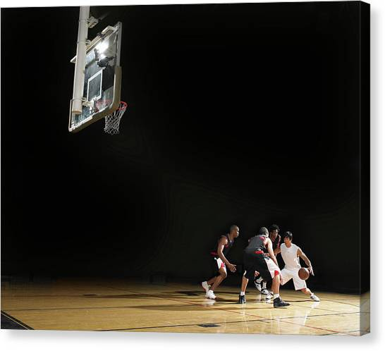 Basketball Players Playing On Court Canvas Print