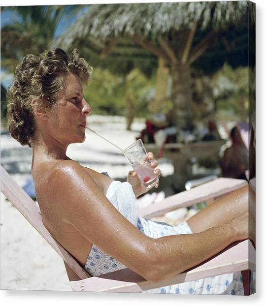 Beach Refreshment Canvas Print by Slim Aarons