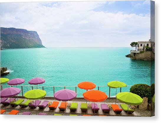 Beach With Parasol In Cassis, France Canvas Print
