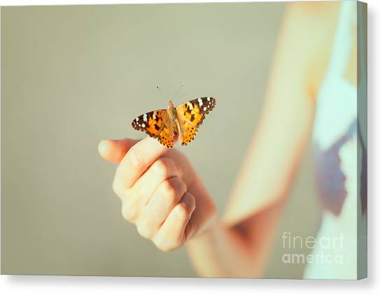 Yellow Butterfly Canvas Print - Beautiful Butterfly Sitting On The Girl by Viktor Gladkov