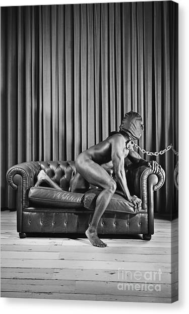 Beautiful Naked Man With Mask Posing On A Sofa Canvas Print