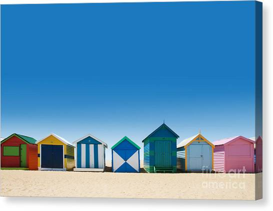 Sandy Beach Canvas Print - Beautiful Small Bathing Houses On White by Creativa Images