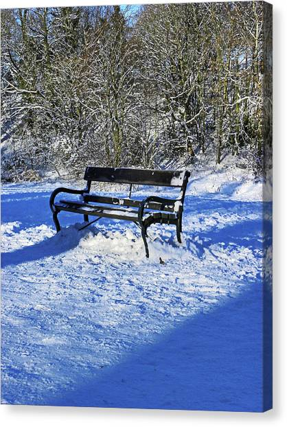 Bench In The Snow Canvas Print
