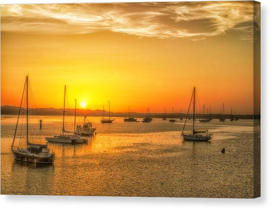 Boats At Sunset Canvas Print by Fernando Margolles