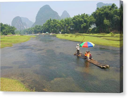 Bomboo Raft On Li River At Sunset In Canvas Print