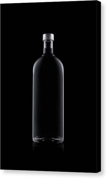 Bottle Of Water Isolated On Black Canvas Print