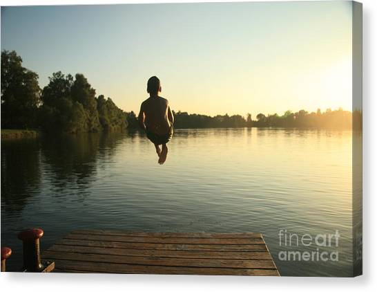 Happiness Canvas Print - Boy Jumping Into A Lake From A Dock At by David Polite
