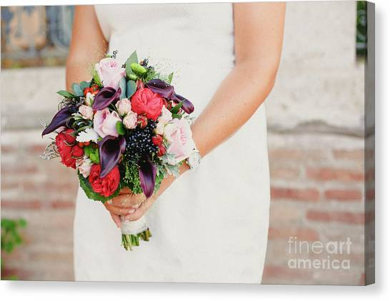 Bridal Bouquet Held By Her With Her Hands At Her Wedding Canvas Print