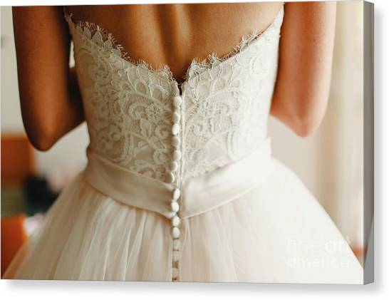 Bride Getting Ready, They Help Her By Buttoning The Buttons On The Back Of Her Dress. Canvas Print