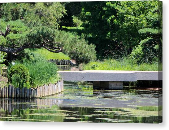 Bridge Over Pond In Japanese Garden Canvas Print