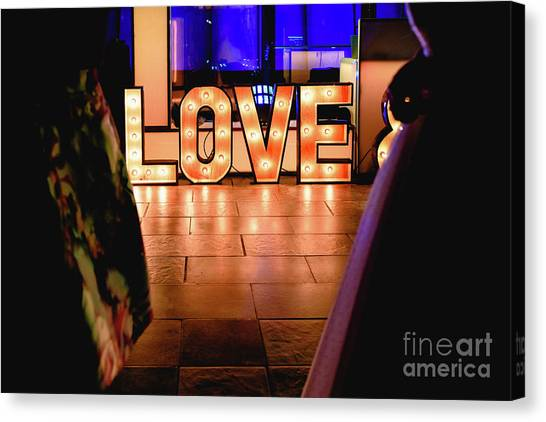 Bright Wooden Letters With Word Love In A Party Canvas Print
