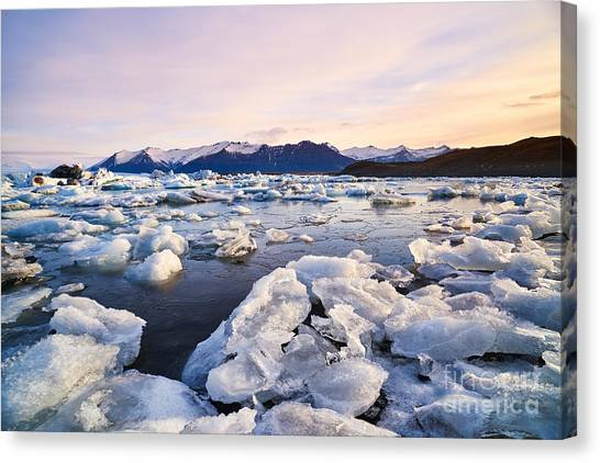 Change Canvas Print - Broken Melting Pieces Of Ice At by Daxiao Productions