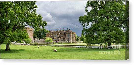 Broughton Castle In Spring Panoramic Canvas Print by Tim Gainey