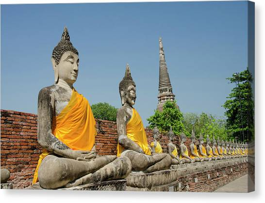 Buddha Statues Dressed In Yellow Robe Canvas Print
