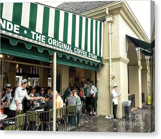 Cafe Du Monde Situation In New Orleans Canvas Print by John Rizzuto