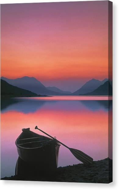 Canoe On Shore At Sunset Canvas Print