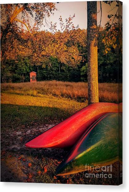 Canvas Print featuring the pyrography Canoes And A Boathouse by Rachel Hannah