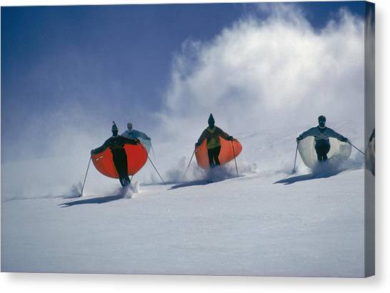 Caped Skiers Canvas Print by Slim Aarons