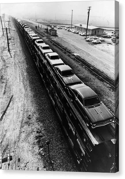 Car Train Canvas Print by Fox Photos